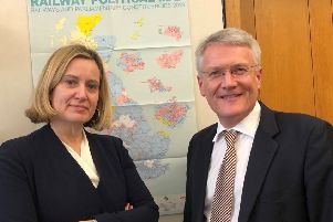 Amber is pictured with Andrew Jones, the Minister responsible for rail SUS-190225-114422001