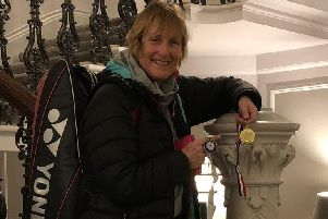 Cathy Bargh proudly displays the two medals she won in York