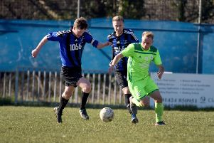 Action from Hollington United's recent home game against AFC Ringmer