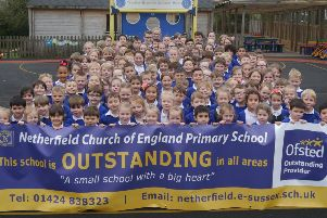 Pupils from Netherfield School hold up a banner celebrating the school's outstanding rating by Ofsted. SUS-190322-132834001