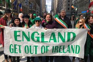 Mary Lou McDonald stands behind the controversial St Patrick's Day banner in New York