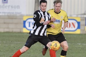 Reece Moody (stripes) who scored a hat-trick for Brigg Town CIC in their cup victory against Louth EMN-190325-095502002