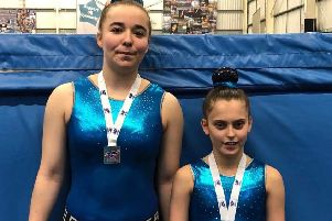 Zara Hyland and Maddie Luke with their medals at the final regional qualifying event