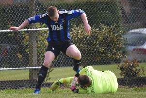 Jay Tomlin challenges the Cuckfield Rangers goalkeeper. Picture by Justin Lycett