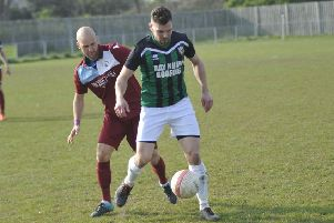 Little Common player-manager Russell Eldridge closes down a Pagham opponent. Picture by Simon Newstead