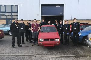 College students with Reliant Robin SUS-190504-094026001