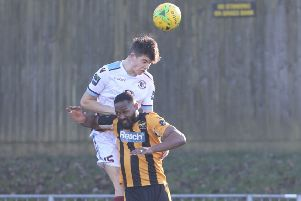Jamie Fielding wins a header for Hastings United against East Grinstead Town during February. Picture courtesy Scott White
