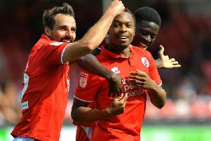 Crawley Town's Filipe Morais congratulates Ashley Nathaniel-George for his goal during Reds' 1-1 draw with Notts County on Bank Holiday Monday. Picture by Steve Robards