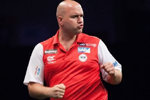 Rob Cross in action at last year's World Cup. Picture courtesy PDC