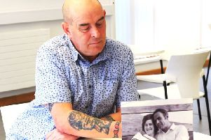 Philip Cloete with a photograph of his parents. (Photo: Donal Dunn).
