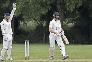 March Town wicket-keeper Andrew George successfully appeals for lbw in the narrow win over Thriplow. Photo: Pat Ringham.