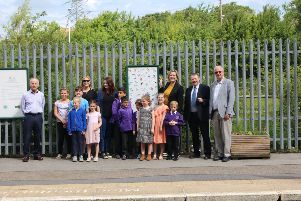 John Spencer, Carly Welch, Anna Beck, Amber Rudd MP, Kevin Boorman and Trevor Davies at Ore station, along with some pupils from Baird Academy who created the artwork at the station. Photo by Harri Boorman.