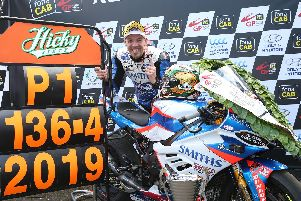 Peter Hickman set a new world road racing lap record of 136.416mph as he won the opening Superbike race at the UIster Grand Prix on Thursday.