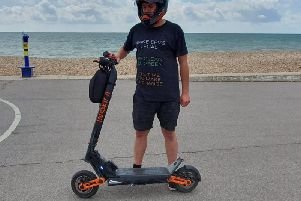 Greg Clayton on his electric scooter