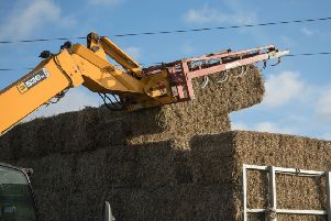 Drivers of large vehicles, such as this hay baler, are being urged to look out for overhead power lines to avoid a potentially-fatal accident. Image for illustration only.