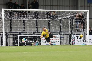 AFC Dunstable goalkeeper Dan Green is beaten by Steve Diggin's first penalty as Corby Town claimed a 2-0 win at Steel Park. Pictures by Alison Bagley