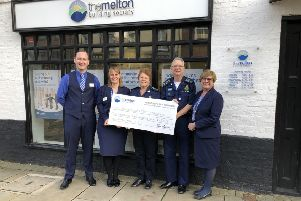 Members of The Melton Building Society hand over a cheque for more than �2,000 to the Melton Community First Responders EMN-200113-162945001