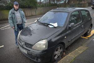 Leonard Chapell pictured with the abandoned car in Sedlescombe Road North