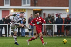 Action from Hastings United's FA Trophy win over Hythe Town. Picture by Scott White