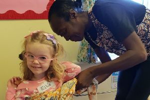 Ellie gets a helping hand from Bemma changing into African dress PHOTO: Supplied