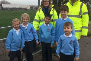 Mr Murley, Mrs Irwin and pupils at one of the entrances to Seaside Primary School