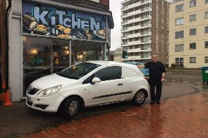 Jason Earl with his car parked on the land outside his restaurant in Brighton Road, Worthing