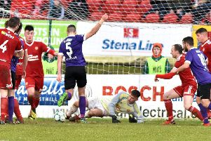 Former Portadown defender Chris Ramsey breaks the deadlock at Shamrock Park during Larne's latest Championship win.