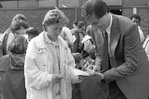 Aylesbury United's Cliff Campbell signing autographs before the game which attracted a record crowd of 6,000 to Buckingham Road