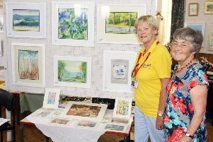 Margaret Bedwell, right, with Valerie Trevor, chairman of Adur Special Needs Project, at the 2018 Shoreham Methodist Church Arts and Crafts Festival. Picture: Derek Martin DM1880054a