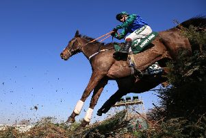 Bishops Road  in action in the Grand National  at Aintree Racecourse.