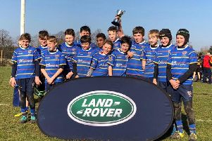 Worthing Rugby Club's under-12 team celebrate with the Land Rover Cup