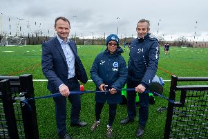 Brighton Women boss Hope Powell (centre) officially opens the new all-weather surface