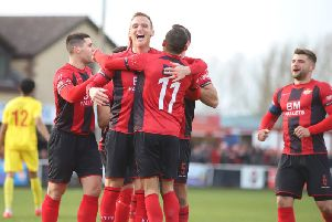 Brett Solkhon takes the congratulations after he scored Kettering Town's third goal in the 3-0 success over Banbury United at Latimer Park. Pictures by Peter Short