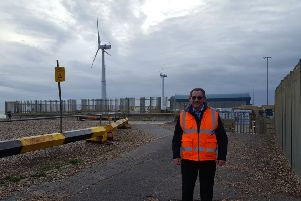 Tony Parker in front of the wind turbines at Shoreham Port SUS-191203-083234001
