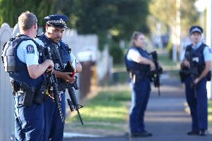 Armed police maintain a presence outside a mosque in Auckland, New Zealand. Picture: Getty Images/Phil Walter