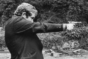Martin McGuinness in his younger days with a pistol.  The Saville Inquiry found he was probably carrying a Thompson sub machine gun on Bloody Sunday.