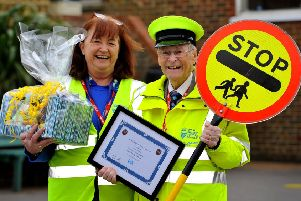 Lollipop man Mike Billington with Julie Holt, assistant co-ordinator, at Swiss Gardens Primary School. Picture: Steve Robards SR1908975