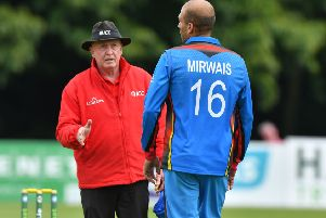 Umpire Alan Neill has words with Afghanistan's Mirwais Ashram. Pic by PressEye Ltd.