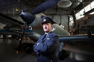 Nicholas Collett with a Spitfire fighter aeroplane at the South Australian Aviation Museum. EMN-190804-155700001