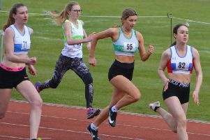 In the white and green Chi Runners vests are Elle Cleasby and Emily Russell / Picture by Lee Hollyer