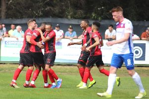 Lathaniel Rowe-Turner takes the congratulations after he scored Kettering Town's goal in the 1-0 win at local rivals AFC Rushden & Diamonds. Pictures by Peter Short
