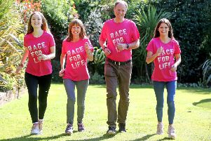 Actress and comedian Zoe Hilson with husband Steve and daughters Tassia and Blaise. Picture: Cancer Research UK