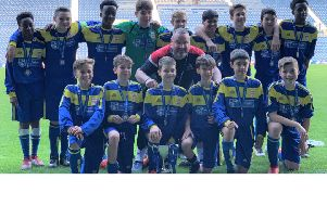 The Claremont School under-13 boys' football team with the trophy after its 7-0 victory at West Bromwich Albion FC