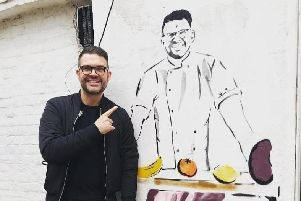 Kenny Tutt with his mural, which could be removed