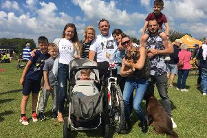 Dale Potton (centre) and his family after he completed 30km