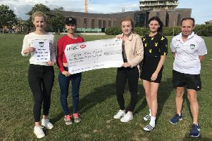 The cheque presentation for Talisa-Mae Marsh at Beach House Grounds. Pictured: Petrina Marsh, Talisa-Mae Marsh, Ellie Ransom, Katie O'Hara and Chris Luesley