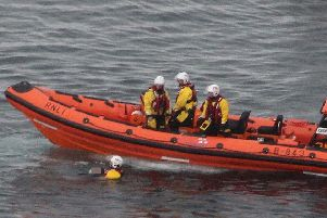 The moment that Red Bay Life Boat Crew saved a mans life at Kenbane head near Ballycastle on Monday evening. Photo: GARETH O BRIEN/MCAULEY MULTIMEDIA