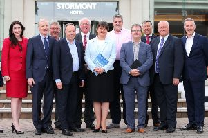 DUP leader Arlene Foster (centre) with her 10 MPs.' IRA victim Jonathan Ganesh has called on all the party's MPs to emulate Nigel Dodds in calling on the Prime Minster to secure compensation for them from Libya