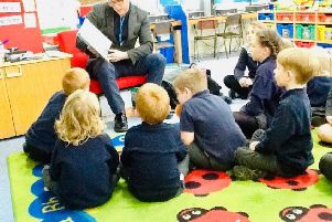 Ryan Hinson during a lesson with young pupils.