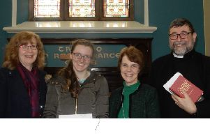 Nicola Wolfe, accompanied by her mother Alison, has received a cheque from Methodist Church lay leader Lynda Neilands and minister Rev. Chris Skillen.
